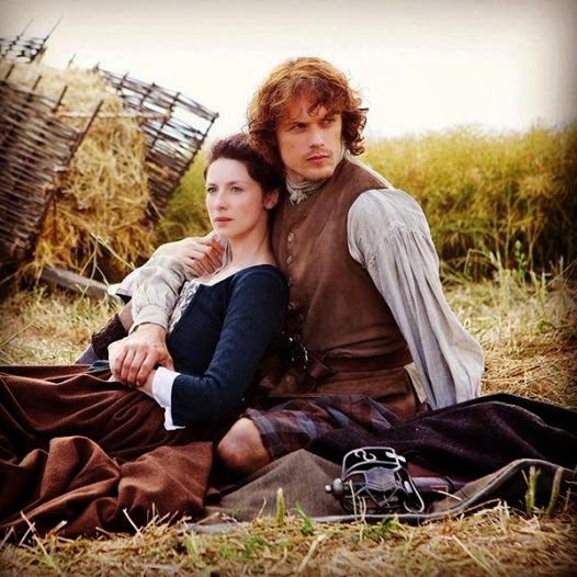Jamie and Claire sitting on hay